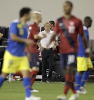 United States head coach Jurgen Klinsmann, center, looks on in the second half of an international soccer friendly game against Ecuador, Tuesday, Oct. 11, 2011, in Harrison, N.J. (AP Photo/Julio Cortez)