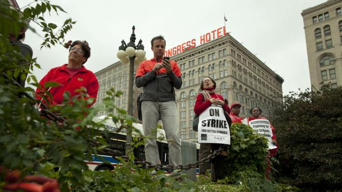 Public school teachers gather at Chicago's Congress Plaza,  protesting against billionaire Hyatt Hotel mogul Penny Pritzker, who is also a member of the Chicago Board of Education on Thursday, Sept. 13, 2012. Protesters said that $5.2 million in Tax Increment Financing (TIF) funds being used to build a new Hyatt hotel in Hyde Park would be better spent on meeting basic student needs. (AP Photo/Sitthixay Ditthavong)