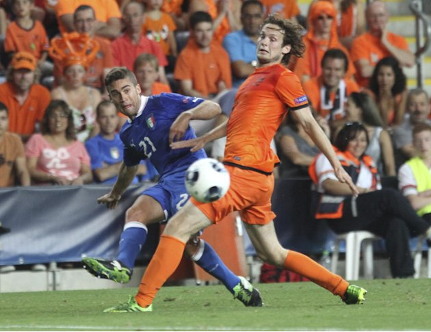 Italy's Fausto Rossi pases tha ball by Daley Blind of the Netherlands during a European U21 Soccer Championship semi-finall match in Petah Tikva, Israel, Saturday, June 15, 2013