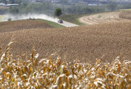 A pickup truck travels a dusty road amidst dry corn fields near Bennington, Neb., Thursday, Sept. 6, 2012. The remnants of Hurricane Isaac dumped heavy rain on some key Midwest farming states that dramatically lessened the drought there, but conditions worsened in two of the nation's biggest corn producers, Iowa and Nebraska, which missed out on the badly needed moisture, according to a drought report released Thursday. (AP Photo/Nati Harnik)