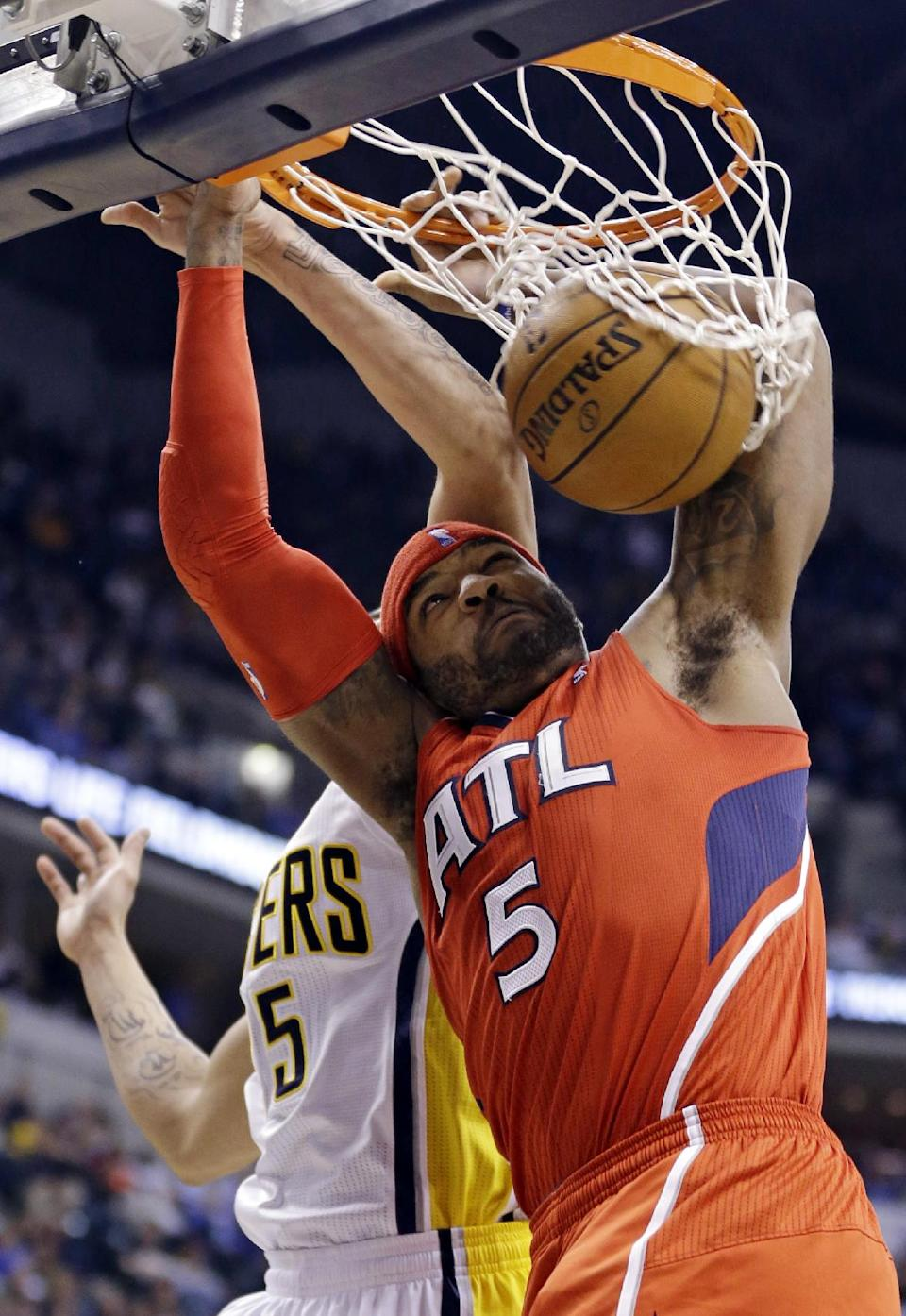 Atlanta Hawks forward Josh Smith (5) dunks under Indiana Pacers forward Gerald Green in the first half of Game 2 of a first-round NBA basketball playoff series in Indianapolis, Wednesday, April 24, 2013. (AP Photo/Michael Conroy)