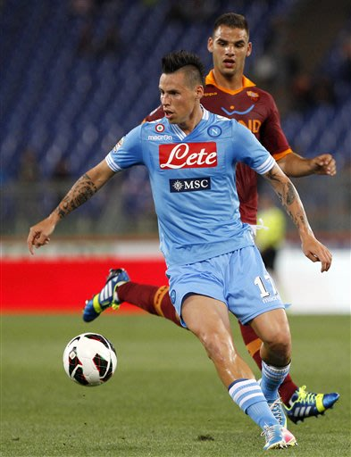 Napoli midfielder Marek Hamsik, of Slovakia, is chased by AS Roma midfielder Panagiotis Tachtsidis, of Greece, right, during a Serie A soccer match between AS Roma and Napoli, at Rome's Olympic stadiu