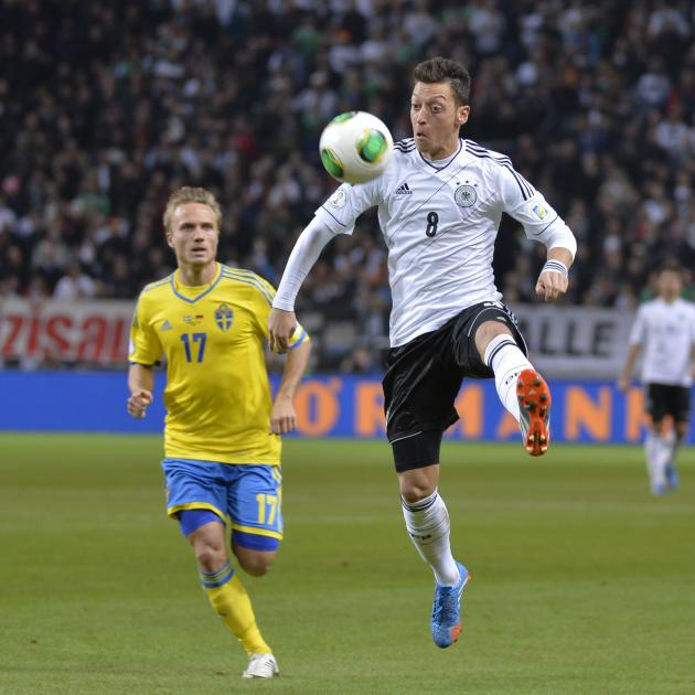 Germany's Mesut Ozil, right, is chased by Sweden's Pierre Bengtsson during the 2014 World Cup group C qualifying soccer match between Sweden and Germany at Friends Arena in Stockholm, Sweden, Tuesday,