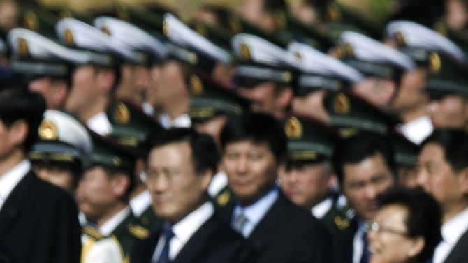 FILE - In this file photo taken Monday, Oct. 1, 2012, Chinese Vice President Xi Jinping, center, walks past President Hu Jintao, right, and Premier Wen Jiabao, left, as he arrives at the Monument to the People's Heroes during a ceremony marking National Day on Tiananmen Square in Beijing. Xi, 59 and the country's vice president is expected to take over as head of the ruling party in November, 2012, before becoming president in 2013 of an increasingly assertive China. Tall and heavyset, married to a popular folk singer in the military, Xi is at ease in groups, in contrast to China's typically stiff and aloof leaders, such as current President Hu Jintao. (AP Photo/Andy Wong, File)