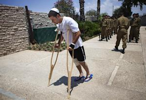 A wounded Israeli soldier arrives for the funeral of…