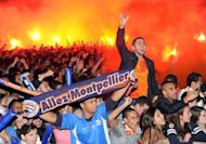 Supporters of the Montpellier L1 football team celebrate in front of a giant screen at the place de la Comedie in Montpellier, southern France. The southern club have been the most consistent team in Ligue 1, never dropping below fourth and spending almost the entire campaign in the top two