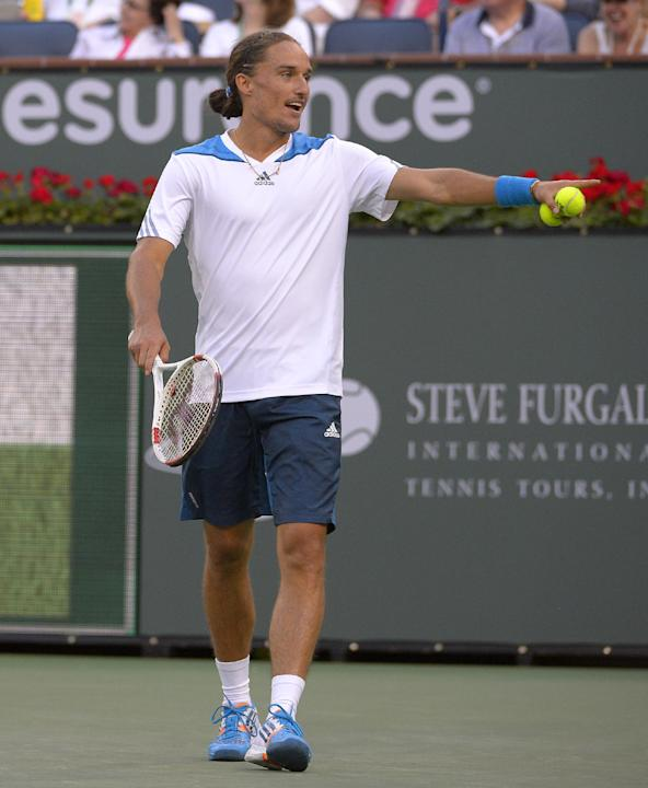 Alexandr Dolgopolov, of Ukraine, reacts to losing his third challenge in just three games against Rafael Nadal, of Spain, during a third round match at the BNP Paribas Open tennis tournament, Monday,