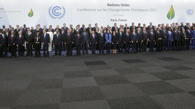 Heads of states and governments pose for a family photo during the opening day of the World Climate Change Conference 2015 (COP21) at Le Bourget, near Paris