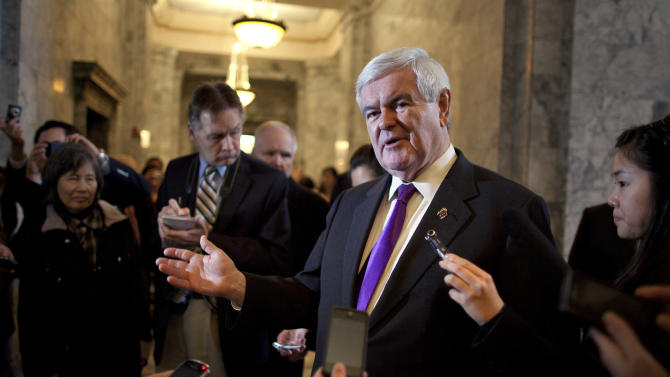 Republican presidential candidate, former House Speaker Newt Gingrich talks to reporters during a visit to the state capital on Friday, Feb. 24, 2012 in Olympia, Wash.  (AP Photo/Evan Vucci)