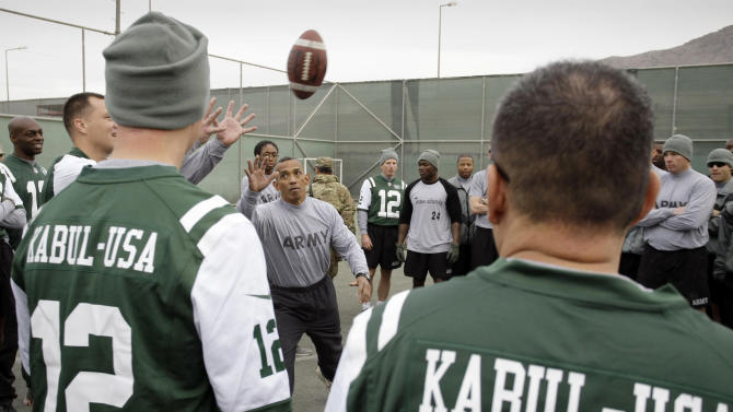 U.S. Army Master Sgt. Wade Manol explains the rules of football to players during a six-team competition to mark Thanksgiving at the U.S.-led coalition base in Kabul, Afghanistan, Thursday, Nov. 22, 2012. (AP Photo/Musadeq Sadeq)