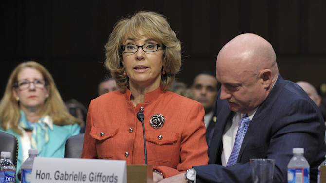 FILE - In this Jan. 30, 2012 file photo, former Arizona Rep. Gabrielle Giffords, who was seriously injured in the mass shooting that killed six people in Tucson, Ariz., in January 2011, is aided by her husband, Mark Kelly, as she speaks before the Senate Judiciary Committee hearing on gun violence on Capitol Hill in Washington. Hundreds of pages of police reports in the investigation of the shooting were released Wednesday, March 27, 2013 marking the public's first glimpse into documents that authorities have kept private since the attack. (AP Photo/Susan Walsh, File)