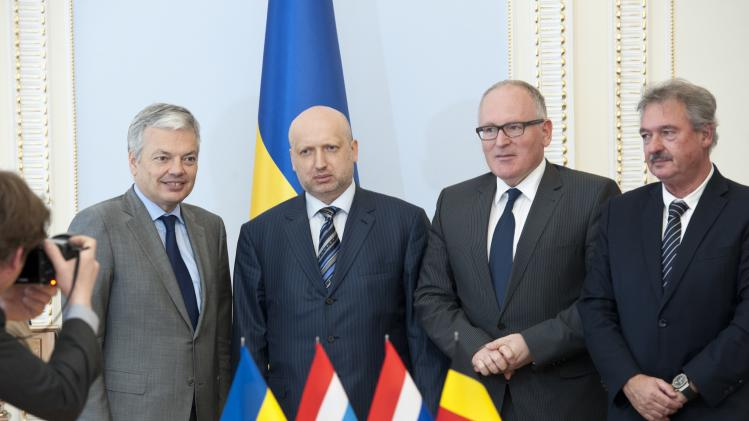 Ukraine's acting President Oleksander Turchinov pose for a picture with foreign ministers during a meeting in Kiev