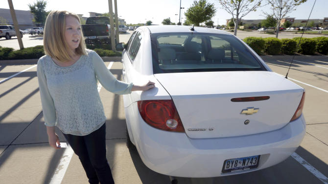 In this April 18, 2014 photo, Wendi Kunkel talks about the issues with getting the ignition switch on her on her 2010 Chevy Cobalt replaced, in Rockwall, Texas. Kunkel was instructed by her dealer to pull everything off her keychain, which GM contends will stop the ignition switches from turning off unexpectedly. But she's still nervous about driving her car on her 30-minute one-way commute. (AP Photo/LM Otero)