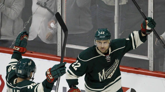 Minnesota Wild right wing Nino Niederreiter (22), of Switzerland, and right wing Jason Pominville (29) celebrate Niederreiter's empty-net goal against the St. Louis Blues during the third period of Game 3 of an NHL hockey first-round playoff series game in St. Paul, Minn., Monday, April 20, 2015. The Wild won 3-0. (AP Photo/Ann Heisenfelt)