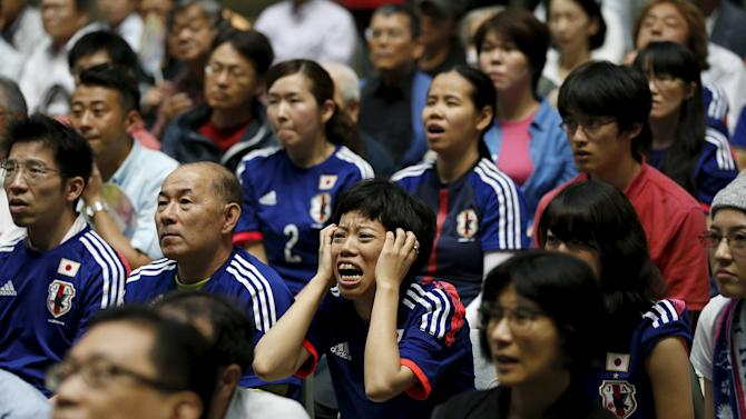 Japan soccer fans react as they watch Japan's FIFA Women's World Cup final match against the U.S. in Vancouver, at a public viewing event in Tokyo