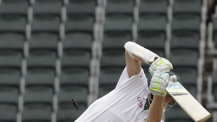 South Africa's batsman Morne Morkel, right, is bowled by Australia's bowler Pat Cummins, unseen, for a duck as teammate Ricky Ponting, left, reacts on the fourth day of the second test cricket match at the Wanderers stadium in Johannesburg, South Africa, Sunday, Nov. 20, 2011. (AP Photo/ Themba Hadebe)