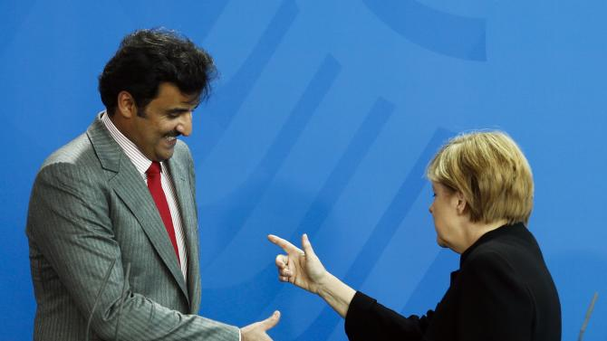 German Chancellor Merkel and Qatar's Sheikh al-Thani attend news conference  in Berlin