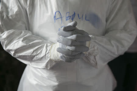 Sierra Leonean doctor practises wearing protective clothing in the Ebola Training Academy in Freetown, Sierra Leone