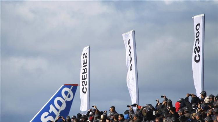 Bombardier employees and guests watch as the CSeries aircraft taxis past for its first test flight in Mirabel, Quebec,