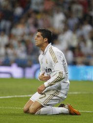Real Madrid's Cristiano Ronaldo from Portugal, reacts during the Spanish La Liga soccer match against Rayo Vallecano at the Santiago Bernabeu stadium in Madrid, Spain, Saturday, Sept. 24, 2011. (AP Photo/Andres Kudacki)