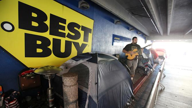 Aaron Rodrigues waits in a line at Best Buy in the Van Nuys section of Los Angeles on Thur. Nov.22,2012. While stores typically open in the wee hours of the morning on the day after Thanksgiving known as Black Friday, openings have crept earlier and earlier over the past few years. Now, stores from Wal-Mart to Toys R Us are opening their doors on Thanksgiving evening, hoping Americans will be willing to shop soon after they finish their pumpkin pie. (AP Photo/Richard Vogel)