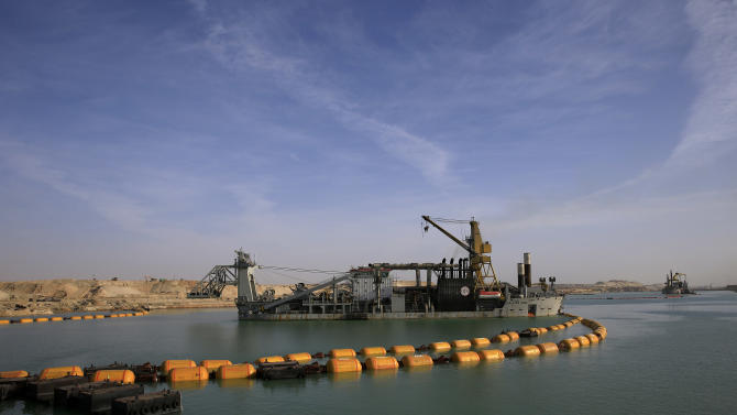 Dredger float on a new section of the Suez canal during a media tour in Ismailia, Egypt, Wednesday, Feb. 4, 2015. The head of the Suez Canal Authority, Mohab Mameesh, says work is on schedule and that so far, 86 percent of the dry digging and 21 percent of the dredging has been completed, with the new section expected to be completed in August 2015.  (AP Photo/Hassan Ammar)