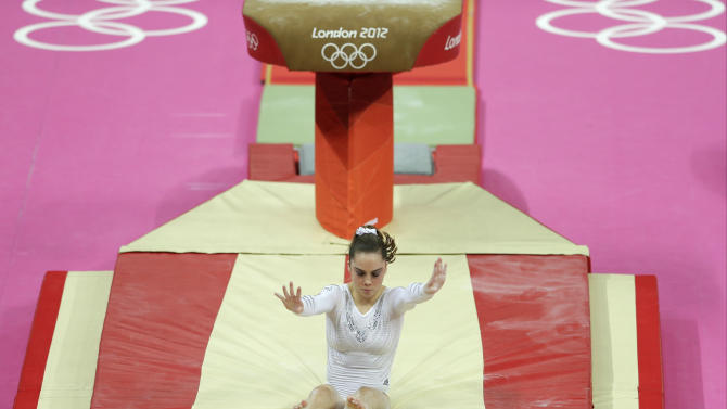 U.S. gymnast McKayla Maroney botches her dismount  during the artistic gymnastics women's vault  final at the 2012 Summer Olympics, Sunday, Aug. 5, 2012, in London. (AP Photo/Gregory Bull)