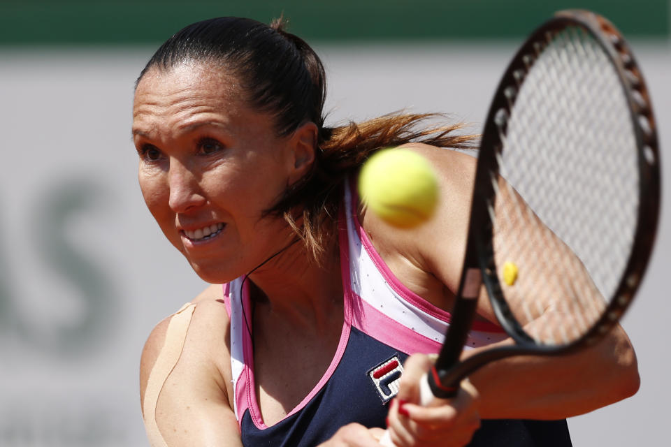 Serbia's Jelena Jankovic returns against Russia's Maria Sharapova in their quarterfinal match at the French Open tennis tournament, at Roland Garros stadium in Paris, Wednesday June 5, 2013. (AP Photo/Petr David Josek)