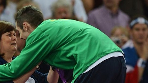 Gold medalist Michael Mckillop of Ireland is presented his medal by his mum Catherine McKillop - Getty Images