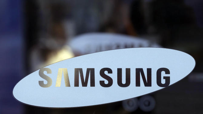 In this Jan. 8, 2013 file photo, Samsung Electronics Co. logo is seen at a showroom of its headquarters in Seoul, South Korea. The firm said Friday, April 5, 2013 its operating profit last quarter rose 53 percent over a year earlier, outpacing expectations for what's normally a slow time for consumer electronics sales. (AP Photo/Lee Jin-man, File)
