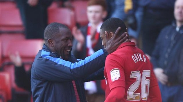 Chris Powell, left, was delighted with Jonathan Obika's, right, late goal