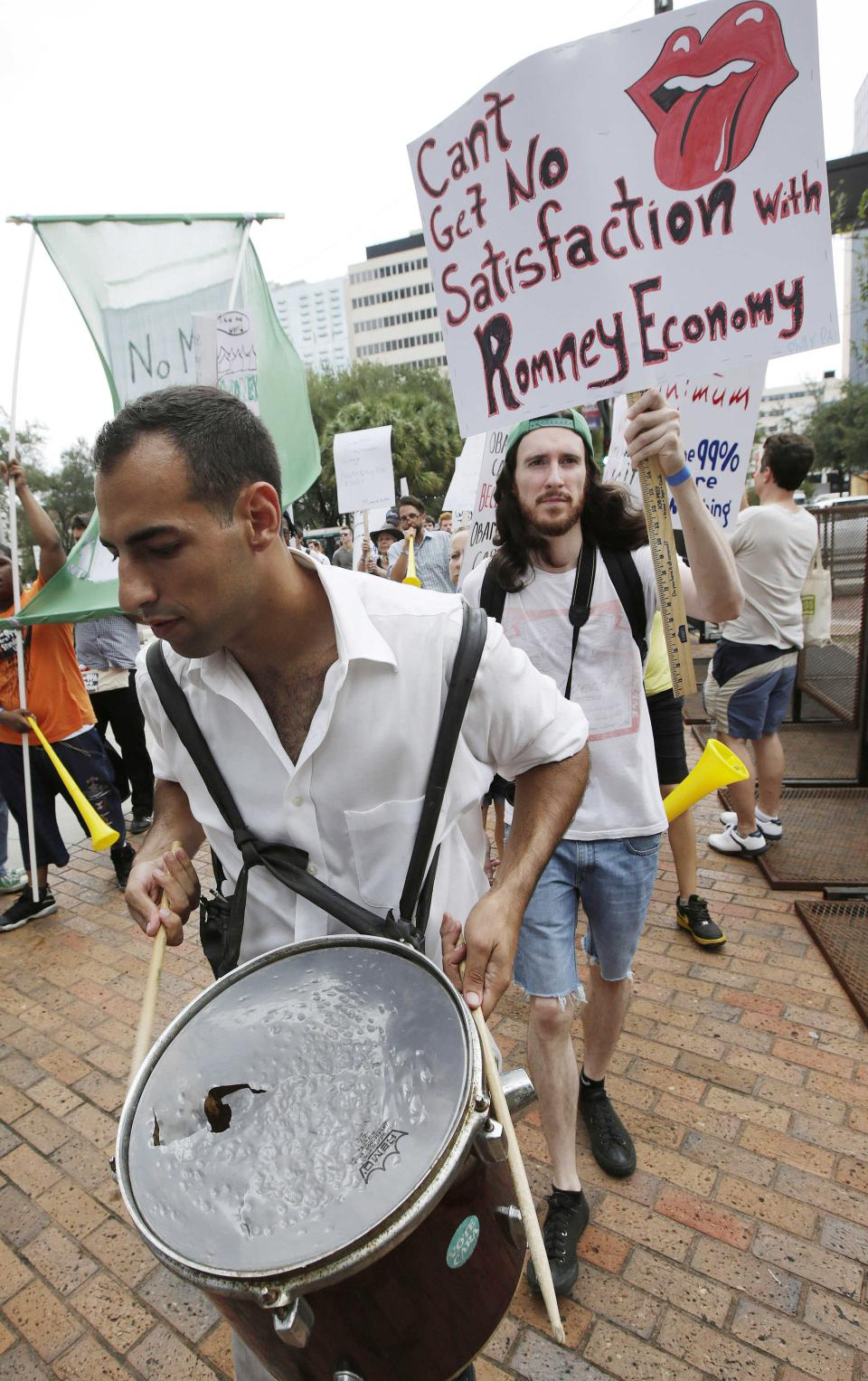 Ganzalo Valdes, of Tampa, Fla., marches with demonstrators in Tampa, Fla., Sunday, Aug. 26, 2012. Hundreds of protestors gathered in Gas Light Park in downtown Tampa to march in demonstration against the Republican National Convention. (AP Photo/Dave Martin)