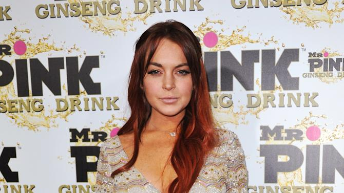 FILE - In this Oct. 11, 2012 file photo, Lindsay Lohan attends the Mr. Pink Ginseng launch party at the Beverly Wilshire hotel in Beverly Hills, Calif. A scheduling hearing for a case alleging Lohan lied to police, drove recklessly and obstructed officers from performing their duties is scheduled for Wednesday, Jan. 30, 2013, before a judge who has previously sentenced the actress to house arrest and jail time. (Photo by Richard Shotwell/Invision/AP, File)