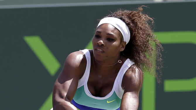 Serena Williams returns to Li Na, of China, during the Sony Open tennis tournament in Key Biscayne, Fla.,  Tuesday, March 26, 2013. Williams won 6-3, 7-6(5). (AP Photo/Alan Diaz)