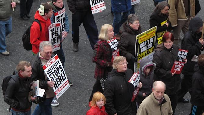 Irish protesters march down Dublin's O'Connell street in a demonstration against a new round of budget cuts and tax rises Saturday, Nov. 24, 2012. The government says it will unveil Ireland's sixth straight austerity budget next month in hopes of reducing the country's 2013 deficit to 8.6 percent, still nearly triple the spending limit that eurozone members are supposed to observe. (AP Photo/Shawn Pogatchnik)