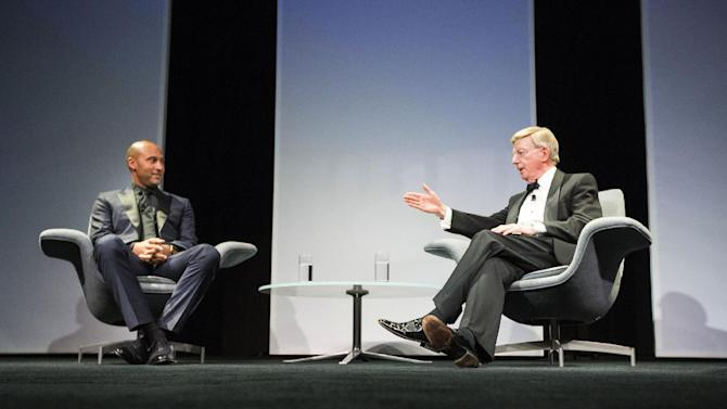 In this photo taken Tuesday, May 26, 2015, columnist and baseball aficionado George Will speaks with retired baseball star Derek Jeter, left, during The 28th Annual Economics Club of Grand Rapids awards dinner at DeVos Place in Grand Rapids, Mich. (Hugh Carey/The Grand Rapids Press via AP) ALL LOCAL TELEVISION OUT; LOCAL TELEVISION INTERNET OUT