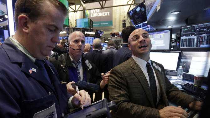 Specialist Henry Becker, right, works at his post on the floor of the New York Stock Exchange Friday, Dec. 21, 2012. Stocks opened sharply lower Friday on Wall Street after House Republicans called off a vote on tax rates and left federal budget talks in disarray 10 days before sweeping tax increases and government spending cuts take effect. (AP Photo/Richard Drew)