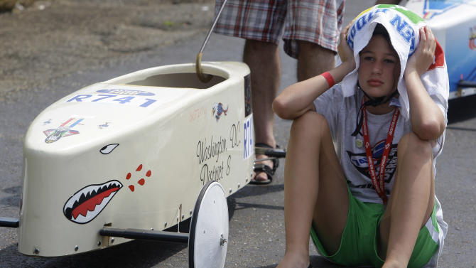 Brittany Sorli, from Waldorf, Md., tries to stay cool as she waits to race in the Rally Stock race at the 74th All-American Soap Box Derby Saturday, July 23, 2011, in Akron, Ohio. (AP Photo/Tony Dejak)