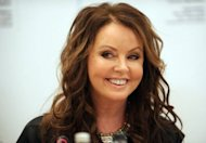 Famed British singer Sarah Brightman smiles during her press conference in Moscow. Brightman announced that she will blast off next year as a space tourist to the International Space Station (ISS) in a voyage aimed at &quot;realising dreams&quot;