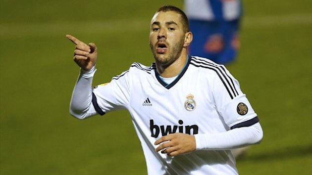 Real Madrid's Karim Benzema celebrates after scoring during the Copa del Rey clash against Alcoyano (AFP)