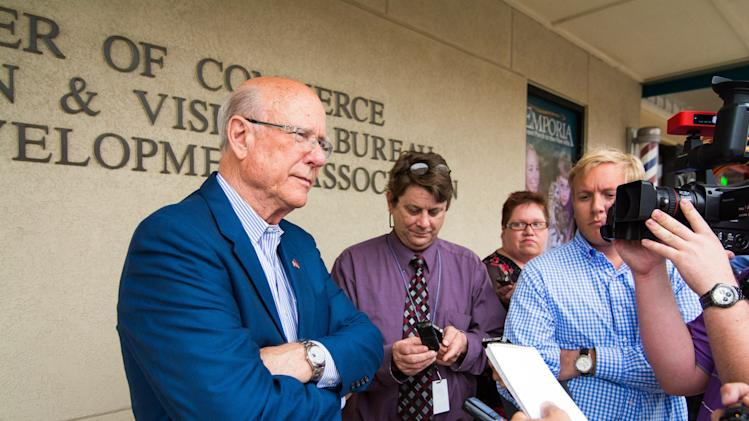 U.S. Sen. Pat Roberts talks with reporters during a campaign stop Wednesday, July 30, 2014 in Emporia, Kan. Tea party challenger Milton Wolf confronted Roberts during a walking tour of downtown Emporia on Wednesday, interrupting the senator's campaign stop to call attention to his refusal to have debates ahead of the Republican primary in Kansas. (AP Photo/Emporia Gazette, Dustin Michelson)