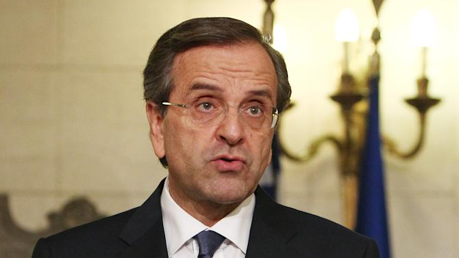 """FILE -  It this Tuesday, Oct. 9, 2012 file photo shows Greece's Prime Minister Antonis Samaras makes statements at Maximos mansion in Athens. Samaras said on Tuesday, Oct. 30, 2012 that the government had essentially ended negotiations on new austerity measures and warned of """"chaos"""" if the reforms are not passed. (AP Photo/Thanassis Stavrakis, File)"""