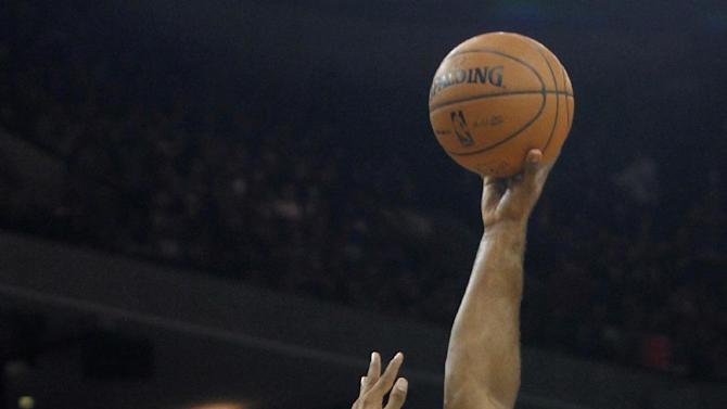 Golden State Warriors' Carl Landry, right, shoots over Boston Celtics' Jared Sullinger during the first half of an NBA basketball game in Oakland, Calif., Saturday, Dec. 29, 2012. (AP Photo/George Nikitin)