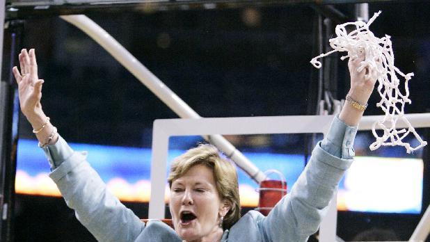 """FILE - In this April 8, 2008, file photo, Tennessee coach Pat Summitt waves to the fans as her son Tyler holds the trophy after the Lady Vols defeated Stanford 64-48 in the NCAA college basketball national championship game at the Women's Final Four in Tampa, Fla. Summitt, the sport's winningest coach, is stepping aside as Tennessee's women's basketball coach and taking the title of """"head coach emeritus"""", the university announced, Wednesday, April 18, 2012. Long-time assistant Holly Warlick has been named as Summitt's successor. (AP Photo/Amy Sancetta, File)"""