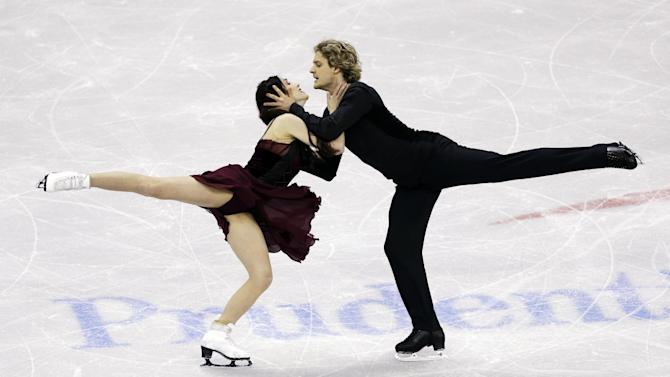 Meryl Davis and Charlie White compete during the senior pairs free dance program at the U.S. figure skating championships, Saturday, Jan. 26, 2013, in Omaha, Neb. (AP Photo/Charlie Neibergall)