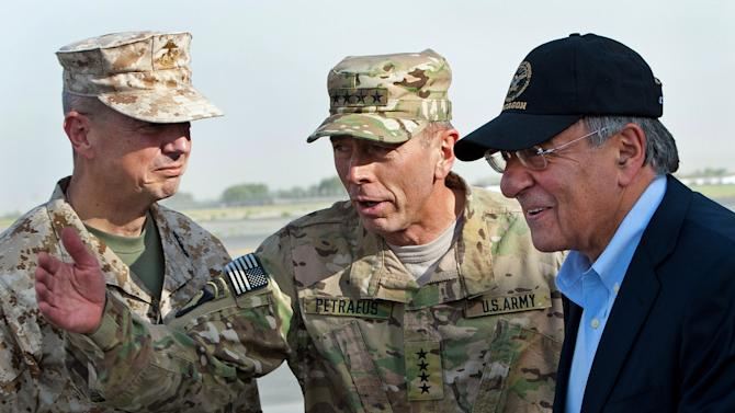 USMC Gen. John Allen, left, and Army Gen. David Petraeus, top U.S. commander in Afghanistan and incoming CIA Director, greet former CIA Director and new U.S. Defense Secretary Leon Panetta, right, as he lands in Kabul, Afghanistan, Saturday, July  9, 2011.  (AP Photo/Paul J. Richards, Pool)