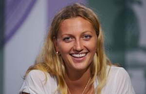 Petra Kvitova of the Czech Republic attends a news conference after defeating Eugenie Bouchard of Canada in their women's singles final tennis match at the Wimbledon Tennis Championships, in London