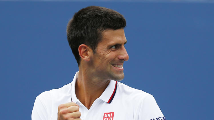 Novak Djokovic, of Serbia, reacts to his box after a shot against Sam Querrey, of the United States, during the third round of the 2014 U.S. Open tennis tournament, Saturday, Aug. 30, 2014, in New York. (AP Photo/Matt Rourke)