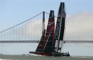 Emirates Team New Zealand and Oracle Team USA sail to the starting line during the 34th America's Cup yacht sailing race in San Francisco, California