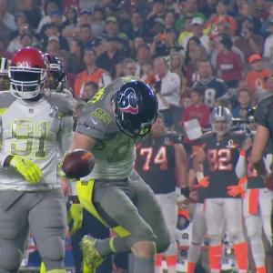 Houston Texans defensive end J.J. Watt recovers fumble by Denver Broncos running back C.J. Anderson